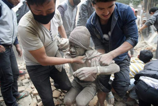 People free a man from the rubble of a destroyed building after an earthquake hit Nepal, in Kathmandu, Nepal, 25 April 2015. A 7.9-magnitude earthquake rocked Nepal destroying buildings in Kathmandu and surrounding areas, with unconfirmed rumours of casualties. The epicentre was 80 kilometres north-west of Kathmandu, United States Geological Survey. Strong tremors were also felt in large areas of northern and eastern India and Bangladesh. EPA/NARENDRA SHRESTHA