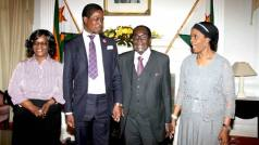 Zambian President Edgar Lungu and his wife seen here President Robert Mugabe and his wife Grace