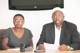 Mr Elton Mangoma addresses a Press conference while flanked by his wife Nancy in Harare yesterday