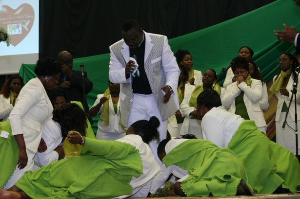 Female worshippers literally fall at shamed preacher Masocha's feet at an Agape service