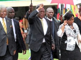 Local Government Minister Ignatius Chombo, Vice President Emmerson Mnangagwa and his wife Auxllia arrive at the National Sports Stadium in this file photo