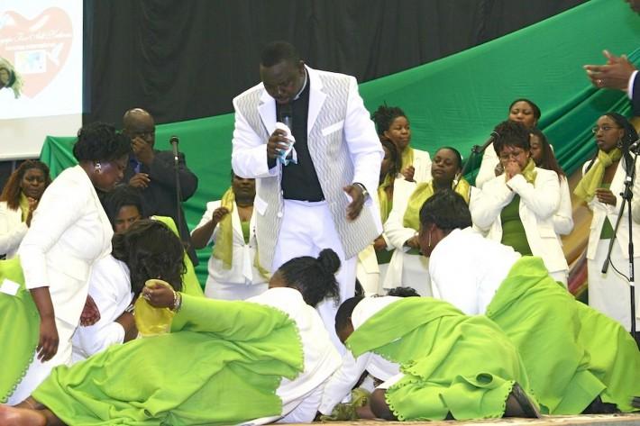Female worshippers literally fall at shamed preacher Masocha's feet at an Agape service