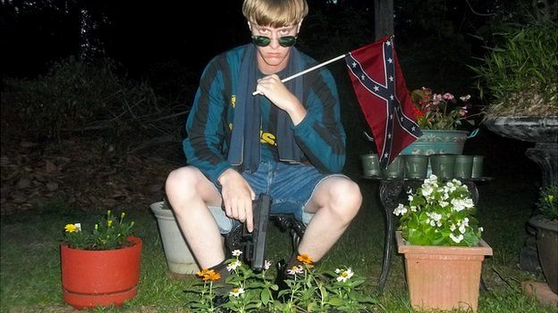 Several of the photographs showed Mr Roof holding a Confederate flag