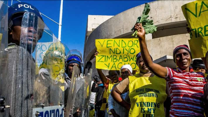 Zimbabwean street vendors march towards Parliament to submit a petition