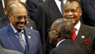 President of the Congo Republic Denis Sassou Nguesso (R) looks on as Sudan's President Omar al-Bashir (L) smiles while being greeted by Zimbabwe's President Robert Mugabe ahead of the African Union summit in Johannesburg. Reuters: Siphiwe Sibeko