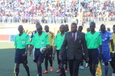 IN THE EYE OF THE STORM . . . Assistant referee Bongani Gadzikwa (left) and fellow match officials follow match commissioner Lovemore Marange as he leads the referees and teams onto the pitch just before Sunday's epic clash between Dynamos and Highlanders