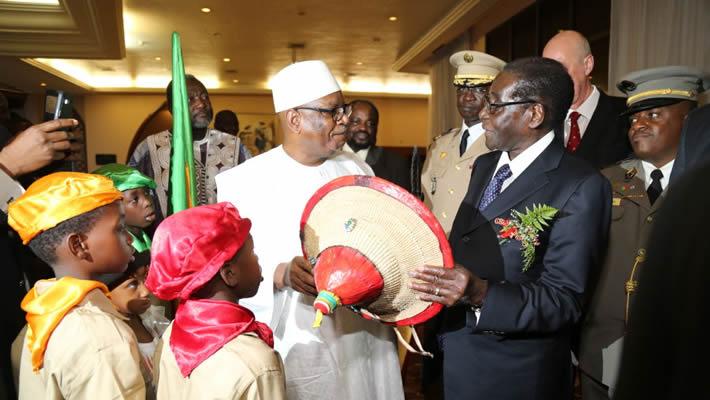 Mali's President Keita seen here with President Mugabe