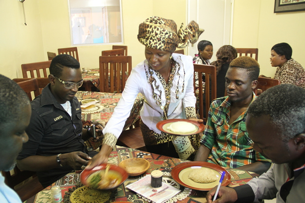 Suluman (left) and Tryson Chimbetu being served at Paroots Restaurant