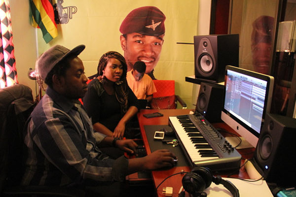 Music producer Humphrey Domboka (left) with singer Cynthia Mare at  JP Studios last week