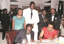 President Mugabe and First Lady Grace Mugabe sign the pictorial biography of the First Lady while Prophetic Healing and Deliverance Ministries leader Prophet Walter Magaya (second from left), his wife Tendai (left) and chairperson of the organising committee for the First Lady's birthday and fundraising dinner Mr Rodney Dangarembizi (extreme right) look on in Harare over the weekend
