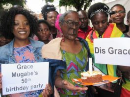 Members of the Zimbabwe Vigil make their views clear on First Lady Grace Mugabe