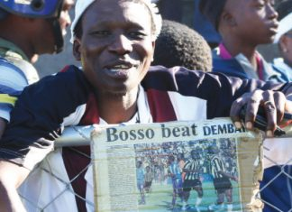 A Highlanders fan displays a Chronicle cutting of the July 30, 2006 edition, the last time Highlanders beat Dynamos 2-0 before Sunday's match. The teams played to a 1-1 draw at Barbourfields Stadium on Sunday. Highlanders have gone for nine years without a victory over Dynamos