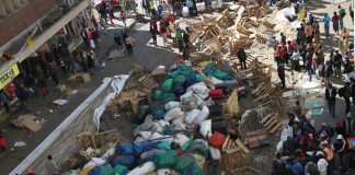 Vendors' wares strewn on the street following a morning raid by municipal police