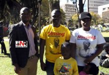 Itai Dzamara's wife Sheffra (right) and his brother Patson (second right) seen with Itai's two children
