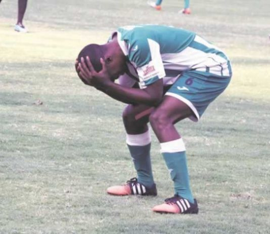 ON NO, NOT AGAIN . . . CAPS United right-back Hardlife Zvirekwi rues another missed chance during yesterday's Castle Lager Premiership match against Dongo Sawmill at the National Sports Stadium. — (Picture by Tawanda Mudimu)