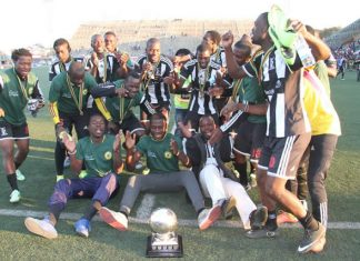 PARTY TIME . . . Highlanders players celebrate their triumph in the Commander Zimbabwe National Army Charities Shield final at Rufaro yesterday