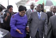 Zimbabwean President Robert Mugabe (R) is greeted by Vice President Joice Mujuru (L) as he returns home to Harare, April 12, 2012, after a trip to Singapore that had ignited speculation the veteran leader was seriously ill. REUTERS/STRINGER