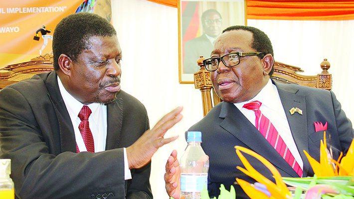 Industry and Commerce Minister Mike Bimha and Zanu PF National Chairman Simon Khaya Moyo