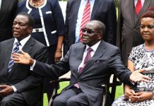 Zimbabwe's President Robert Mugabe sits with his wife Grace Mugabe and Vice President Emmerson Mnangagwa