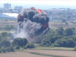 Seven dead as airshow jet crashes on road