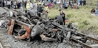 DEATH METAL: Fifteen people died and four were critically injured when a taxi collided with a train in the Shaka's Head area of the North Coast yesterday Paramedics found people and debris spread over a large area (Image by: NETCARE 911)