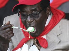 President Robert Mugabe eating icecream