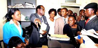 Registra-General Tobaiwa Mudede (in glasses)