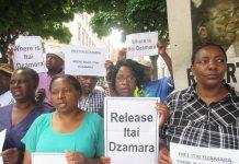 Members of the Zimbabwe Vigil in London demand Itai Dzamara's release