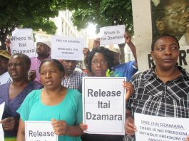 Members of the Zimbabwe Vigil in London demand Itai Dzamara's release