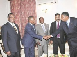 President Mugabe (centre) introduces Africa`s richest man Mr Aliko Dangote (second from left) to Vice President Phelekezela Mphoko (extreme right), while Vice President Emmerson Mnangagwa (left) and Dangote Group executive director Mr Edwin Derakumur Victor (second from right), look on at State House in Harare yesterday. — (Picture by Innocent Makawa)