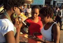 Selmor Mtukudzi (left) sells her CDs in the city