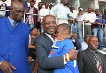 Dynamos chairman Kenny Mubaiwa and Webster Chikengezha (hugging Dynamos player)