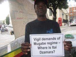 A protester at the Zimbabwe Vigil in London makes a point about Itai Dzamara