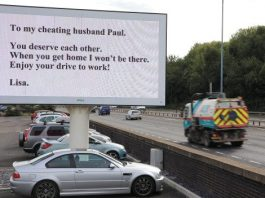 The wife, known only as Lisa, forked out hundreds of pounds for the giant 15ft x10ft message - so that husband Paul would see it on the way to work