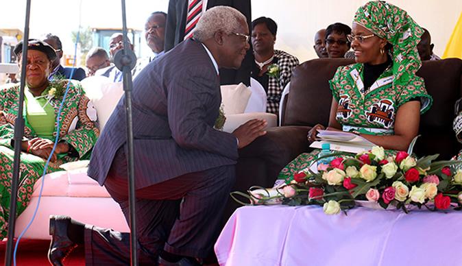 Minister Chombo kneeling before Grace Mugabe at a rally