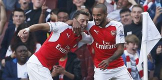 Arsenal players Mesut Ozil celebrating with Theo Walcott