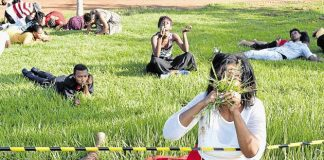 GRASS ROOTS: Members of the Rabboni Centre Ministries, under 'miracle man' pastor Lesego Daniel, eat grass as part of a ritual to show that humans can be controlled by the spirit of God