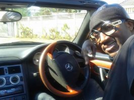 """Gospel rapper Mudiwa """"Hood"""" Mutandwa seen here in his open top convertible Mercedes"""
