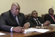 Political activist Fidelis Fengu (right) seen here with Local Government Minister Saviour Kasukuwere (left)