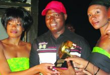 The late Tongai Moyo (centre) receiving a NAMA award
