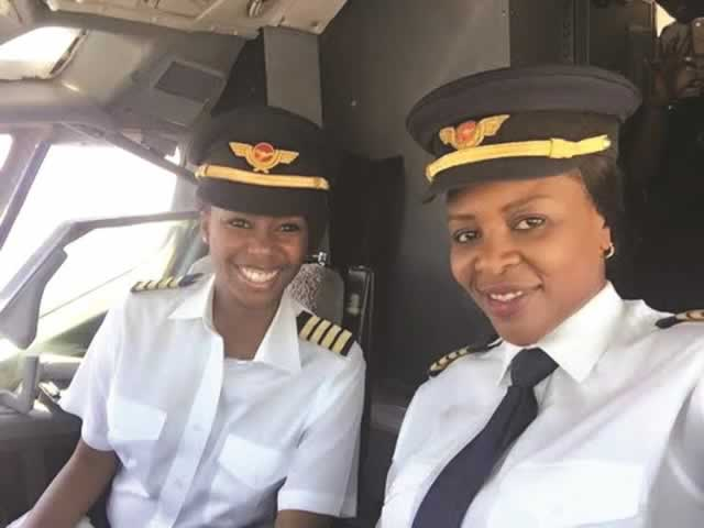 Captains Chipo Matimba (right) and Elizabeth Simbi Petros smile for the cameras before take-off at Harare International Airport en route to Victoria Falls yesterday