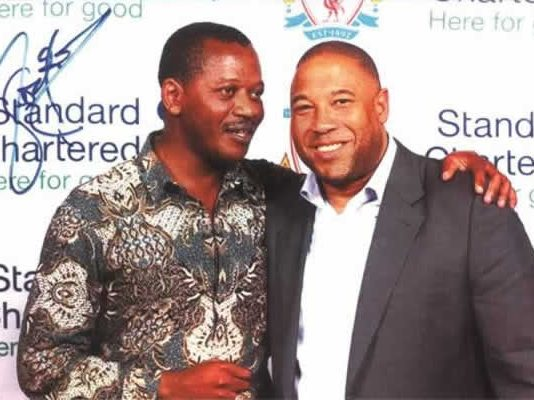 ZIFA presidential candidate Leslie Gwindi seen here with Liverpool legend John Barnes in this file picture