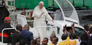 Pope Francis arrives to celebrate Mass at the University of Nairobi on Thursday. Andrew Medichini / AP