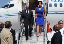 President Jacob Zuma and one of his wives step off a plane