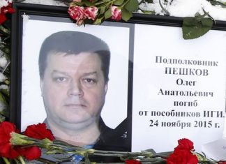 Tributes to Lt Col Oleg Peshkov have been left outside the defence ministry in Moscow