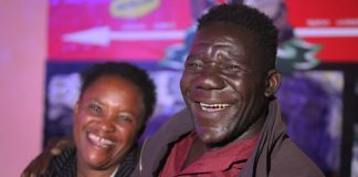 "William Masvinu (R), winner of Zimbabwe's 2012 ""Mr. Ugly"" pageant, poses with his wife, Alice Chabhanga. Chabhanga says she was attracted to Masvinu because of his cheerfulness, kindness, and sense of humor."