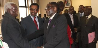 President Mugabe seen here greeting Cephas Msipa (left) during a politburo meeting