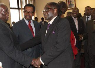 President Mugabe seen here greeting Cephas Msipa (left) during a politburo meeting