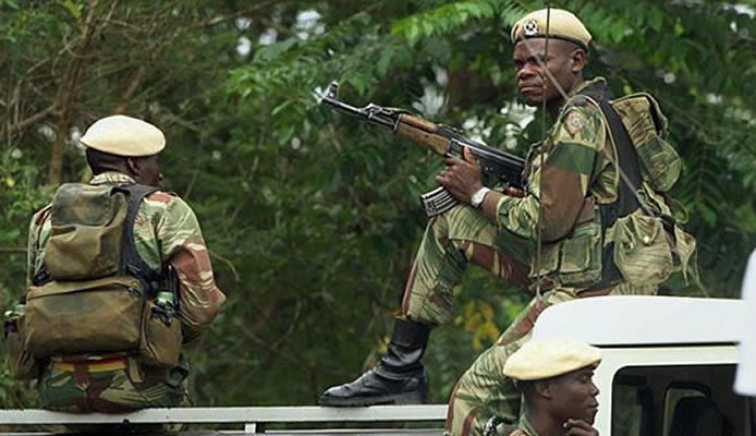 File picture of presidential guard units armed with AK47 rifles