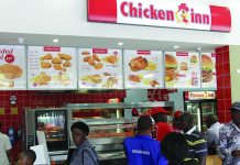 Customers being served at a Chicken Inn